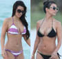 Kim et Kourtney Kardashian en maillot de bain sur la plage de South Beach a Miami